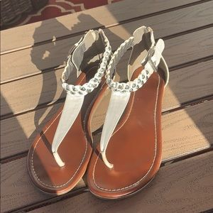 white and brown guess sandles